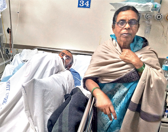 Santosh Salunke (seen here with his mother) has been in the hospital since April 24 (PHOTO BY MAHENDRA KOLHE)