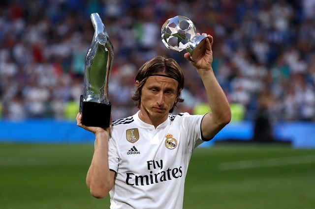 Real Madrid's Luka Modric with the UEFA Men's Player and Midfielder of the Year awards. Reuters Photos