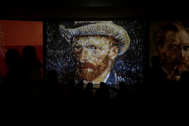 Visitors look at a projection of Vincent Van Gogh's painting, Self-Portrait with Grey Felt Hat, at the Van Gogh Alive exhibition in Athens, Greece, on November 10, 2017. Reuters Photos