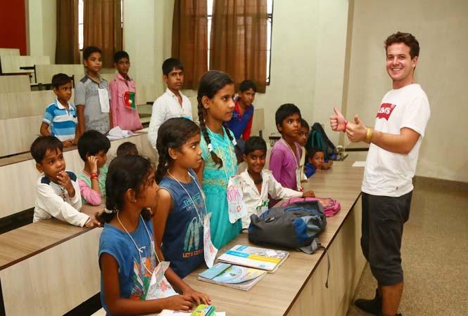 Carlo teaching children at Pornima Pathshala