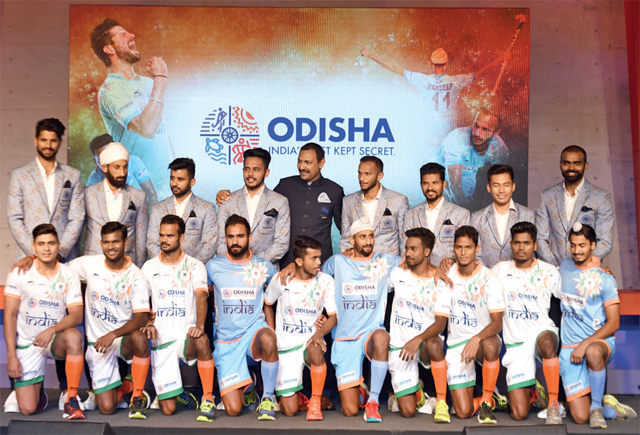 Indian hockey players with new jerseys, unveiled yesterday, for upcoming World Cup