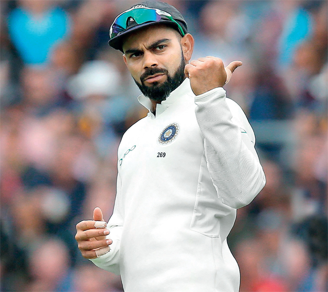 Virat Kohli arranging the field during the second day of the final Test against England yesterday