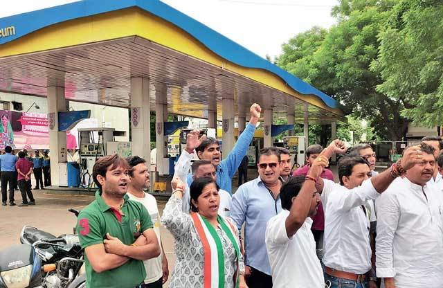 a few of them were seen protesting outside a petrol pump