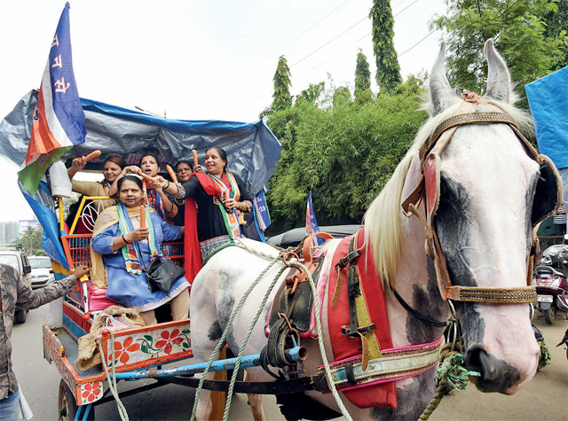 Women workers of MNS take part in a horse cart rally.