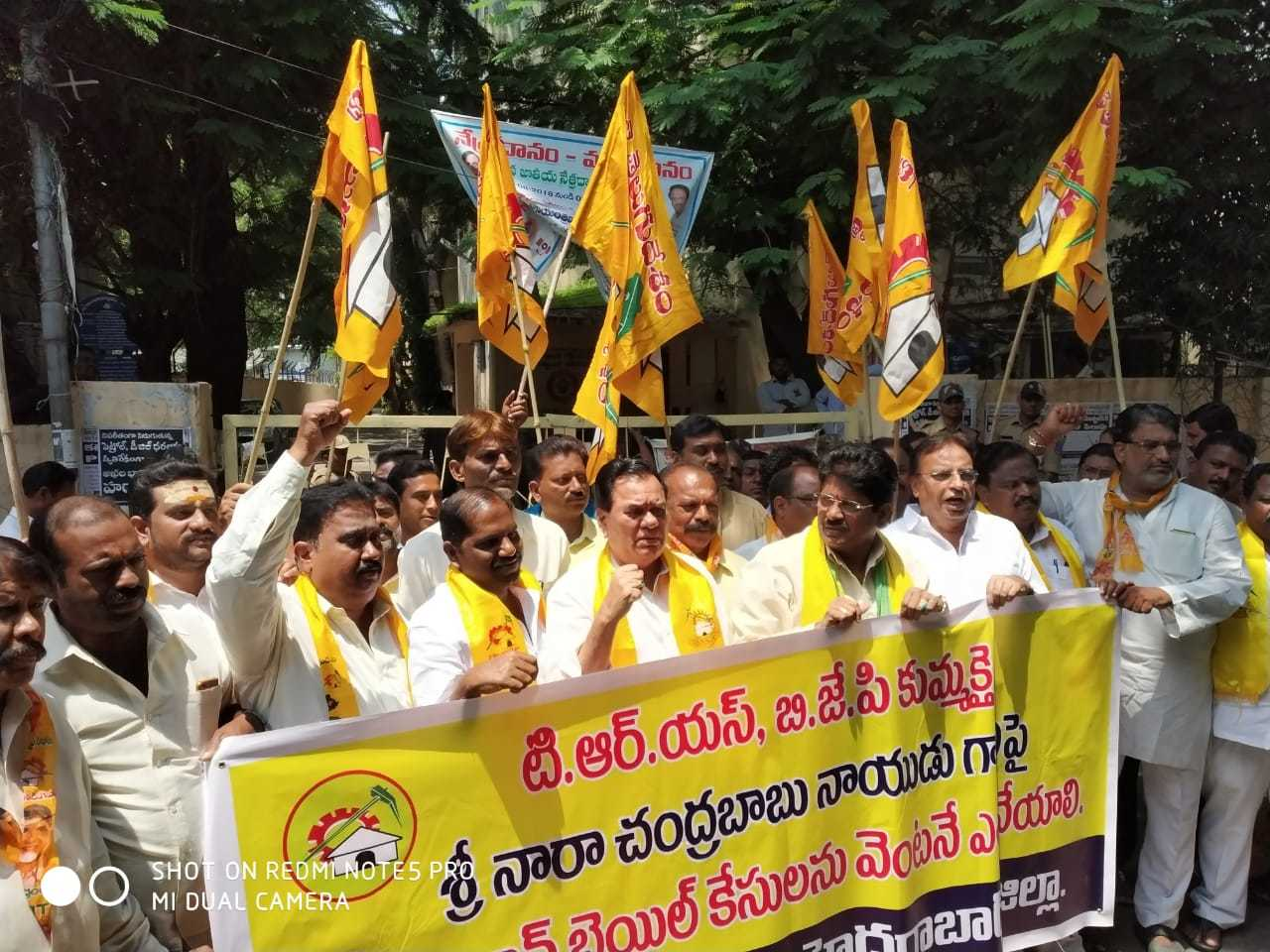 TDP members staged protests against the warrants in Hyderabad on September 14