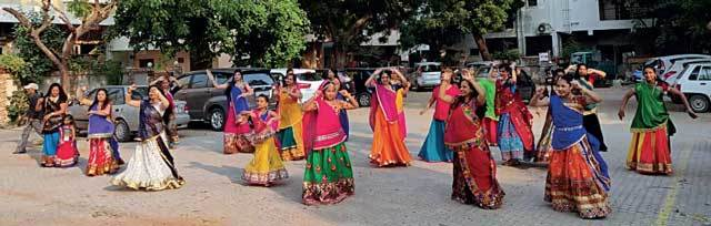 Residents of Ashok Nagar Society match their steps with dancers Riya and Purva. They have been taking garba lessons for the past 10 days