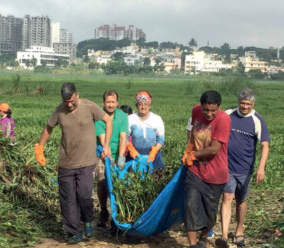 Residents work to clean Hulimavu Lake