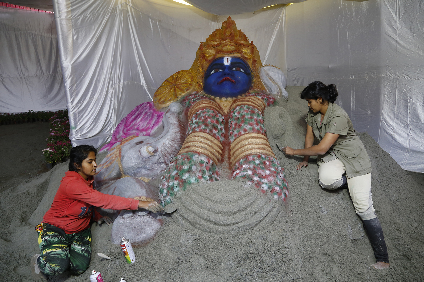Gowri, Nilambika working on the sand art