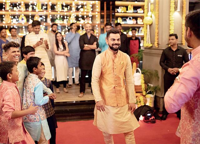 Virat Kohli with the kids