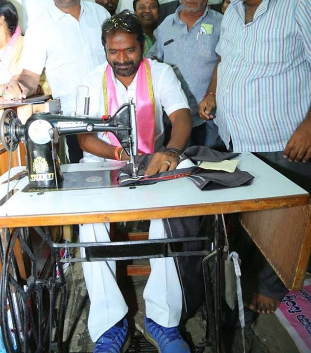 TRS candidate Srinivas Goud tries his hand at sewing clothes