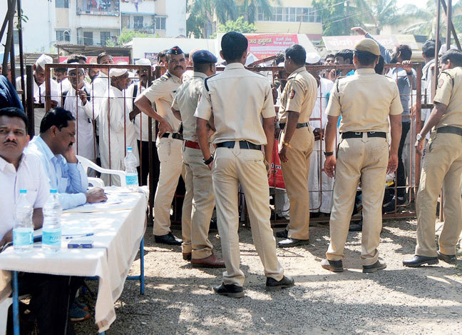 Several farmers who lost their land to construction of Bhama Askhed dam lined up outside Khed deputy collector's office to get alternate land parcels amidst heavy police bandobast