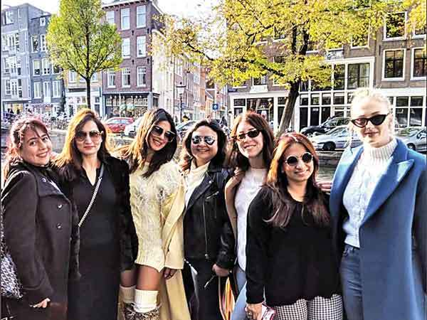 BOATS BLING AND BRIDE GOALS  Priyanka on a boat for her bachelorette in Amsterdam  The actress with her girl squad during the trip