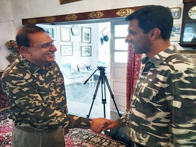 Nawab Shafat Ali congratulates his son Asghar Ali.