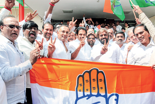 Jubilant Congress leaders after trouncing BJP in the bypolls