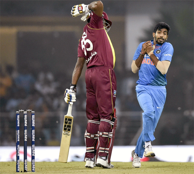 Jasprit Bumrah takes a catch to dismiss Kieron Pollard in the second T20I in Lucknow