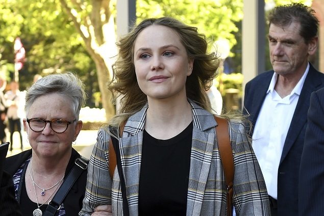 Actress Eryn Jean Norvill (center) leaves the Federal Court in Sydney on October 30, 2018, after giving evidence during the defamation trial. AAP Image via AP