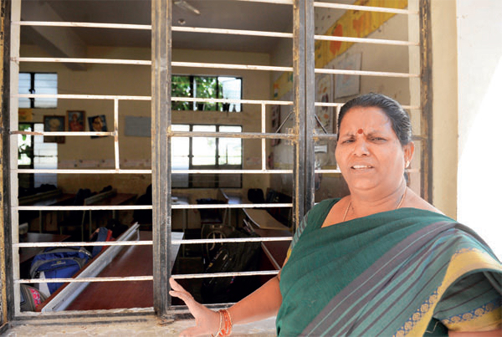 The head mistress of the school in HSR Layout, Mary Angela, points to the damage caused by the vandals