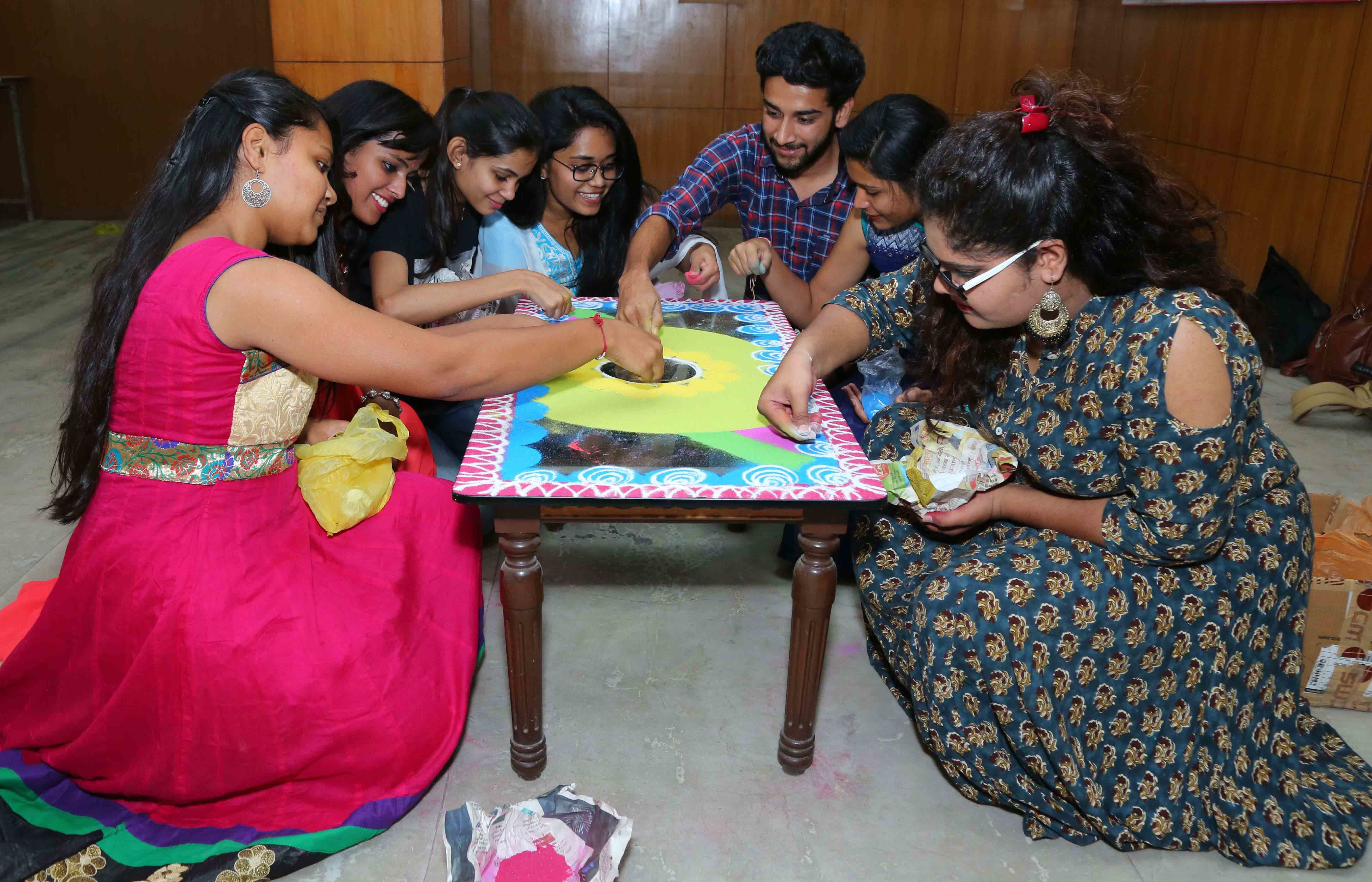 Spending more time with each other in activities like rangoli