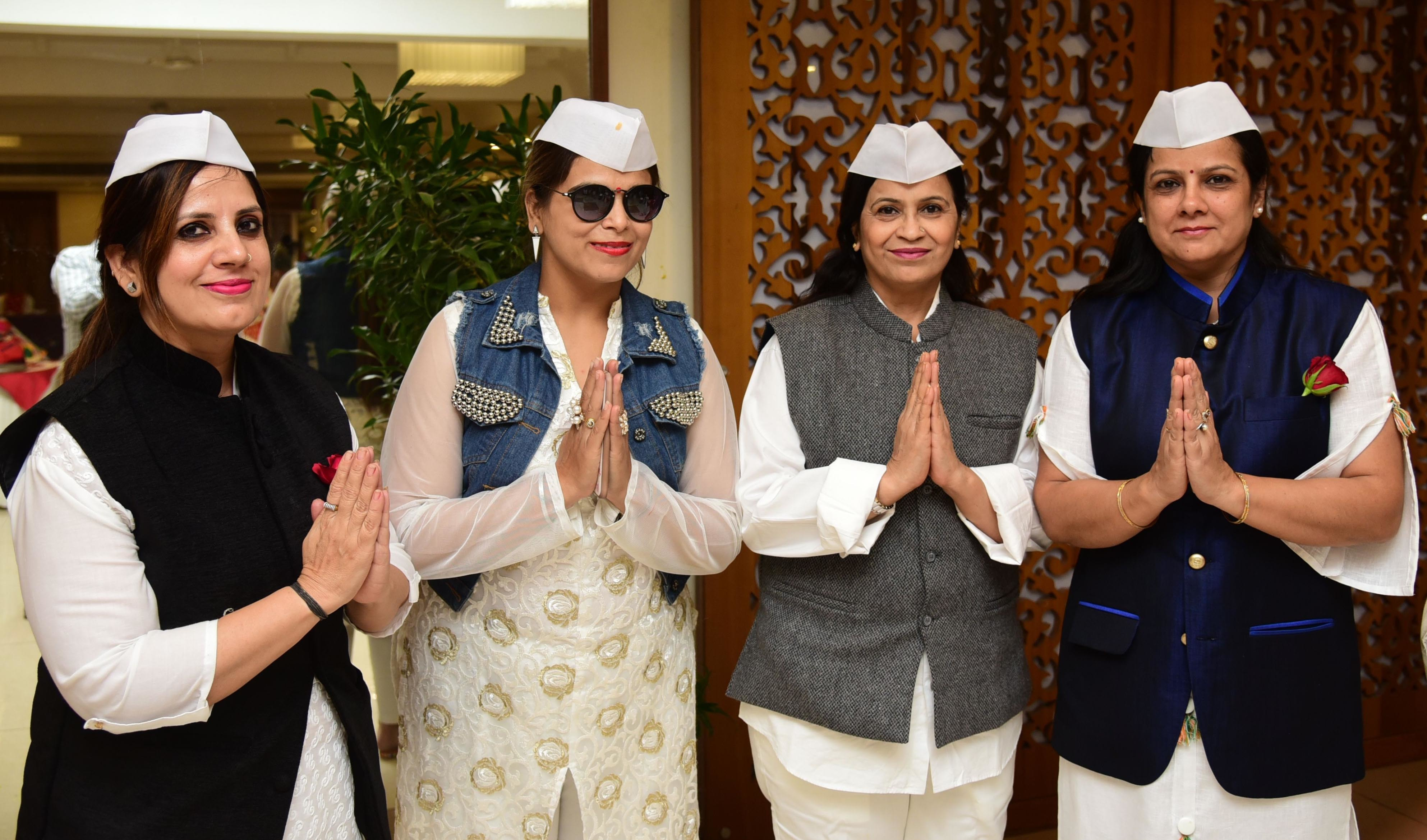 Members welcoming the ladies in full political swag.