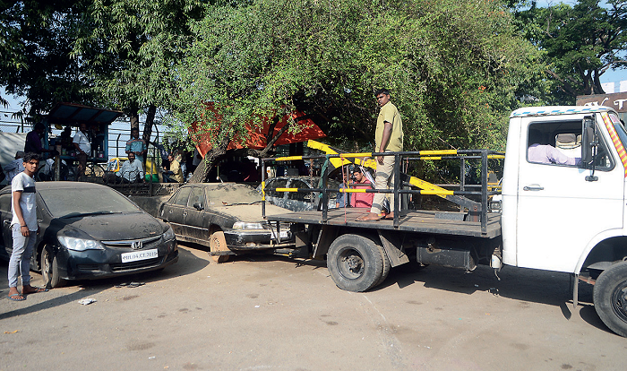 Khataara cars are being removed from Indiranagar's streets and parked at a temporary spot in the area's BDA compound