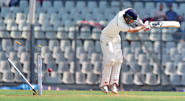 BOWLED BUT NOT BEAUTIFUL! Unlucky Siddhesh Lad loses his stumps to a shortish one that kept extremely low at the Wankhede during Day 3 of the Ranji match between Mumbai and Gujarat.