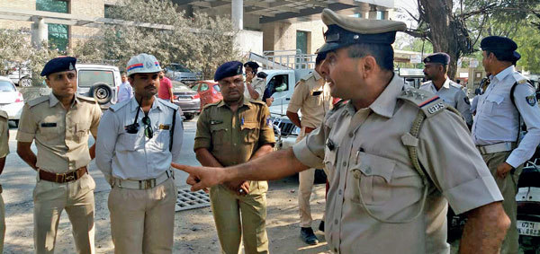 Inspector (Traffic) K D Nakum instructing his men on how important it is to ensure the route is free of pedestrians, vehicles