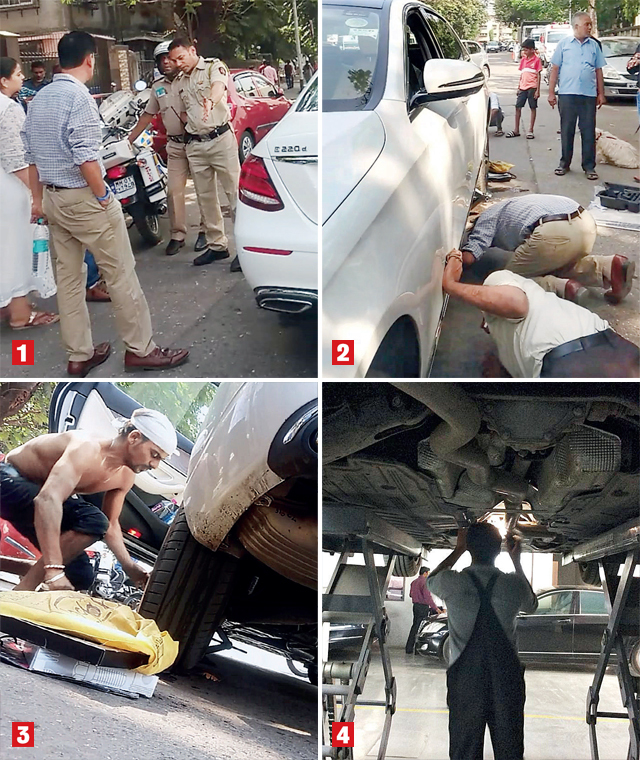 1. A team from the Sion police at the spot where businessman Jayesh Tailor stopped his Merc after hearing a constant soft mew from under the car on Thursday afternoon. 2. The car's underside was examined to find a way to safely remove a stowaway kitten. 3. A mechanic was summoned to the scene, but finally, the car was taken to a workshop where technicians spent three hours to remove parts and bring out the cat. It appeared to be in a good shape and quickly found a new home: a staff member offered to adopt the little fellow