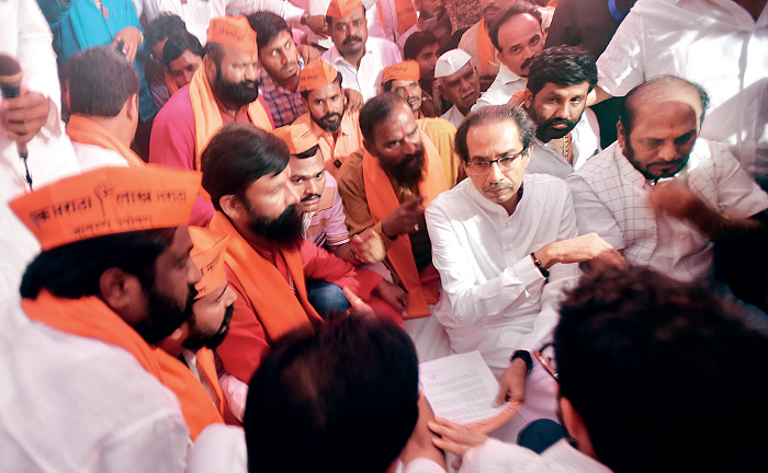 Uddhav Thackeray with Maratha protesters after the State legislature passed the reservation bill unanimously