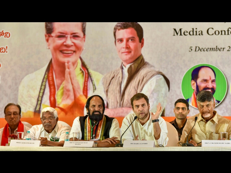 Congress chief Rahul Gandhi flanked by Andhra Pradesh CM N Chandrababu Naidu (R) and TPCC President N Uttam Kumar Reddy at a joint media conference in poll-bound state, in Hyderabad. Photo: PTI
