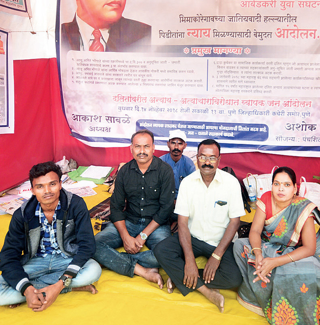L-R: Bhongade and Sable at the collector's office, with two other riots victims, Ashok and Rama Athavale