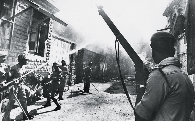 Police personnel at a scene of rioting in the city in 1993