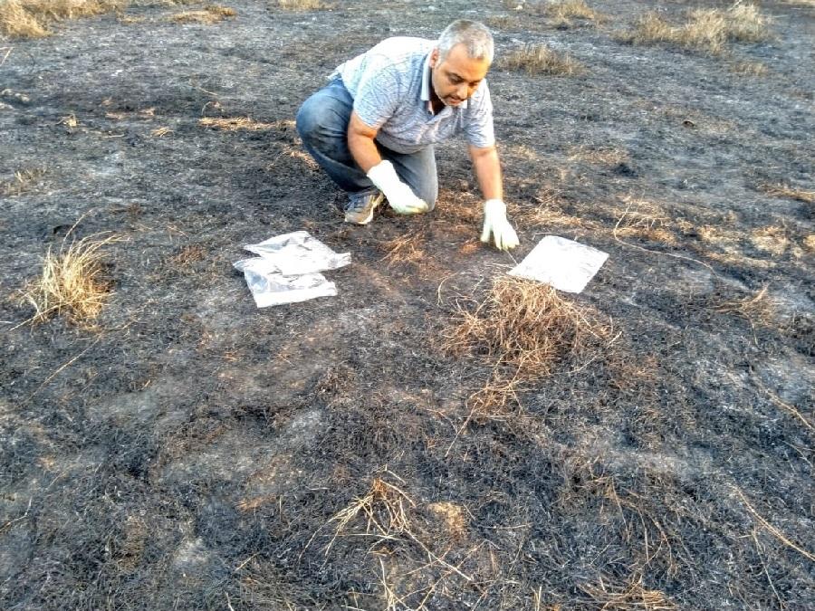 Subhajit Mukherjee collecting samples for forensic testing