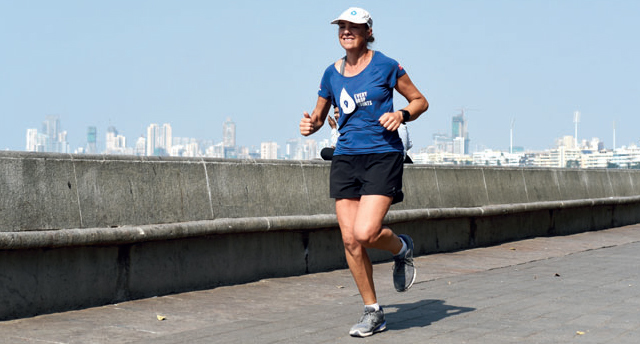 Mina Guli runs at Marine Drive yesterday for the #RunningDry initiative