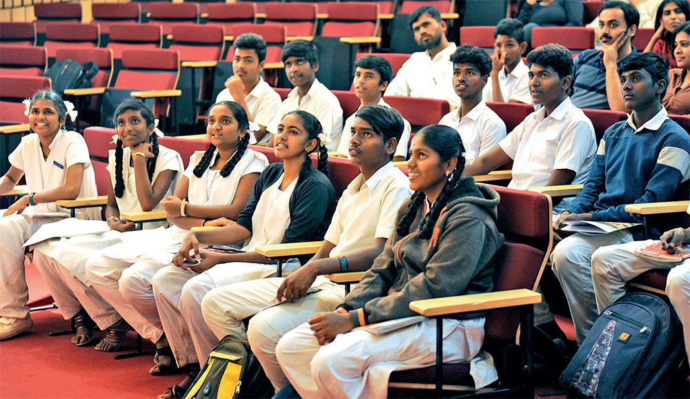 Students from a government school listening to the science talk at NCBS in the city