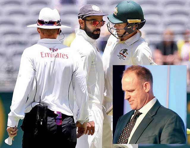 BATTLE OF THE SKIPPERS! Things get heated between India's Virat Kohli (centre) and Australia's Tim Paine during the 2nd Test in Perth