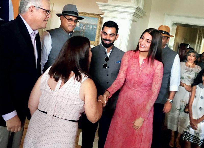 Anushka Sharma and Kohli with the Morrisons, with Shastri (straw hat, partly obscured) and his wife Ritu