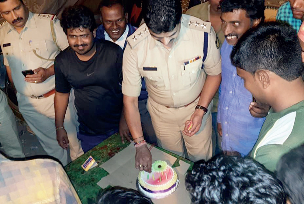 Mico layout police personnel cutting new year cake with residents of Gulbarga Colony