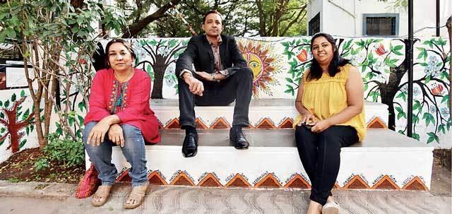 (L–R) Art teacher Neha Asher, the society's chairman Rupendra Sandhir and resident Nancy Thakkar, who organised the community project