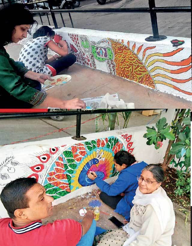 The wall-painting project brought the housing society's residents out to their homes, enabling them to interact and collaborate in the exercise