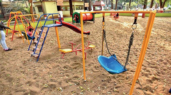 A swing in the toddlers' play area is broken