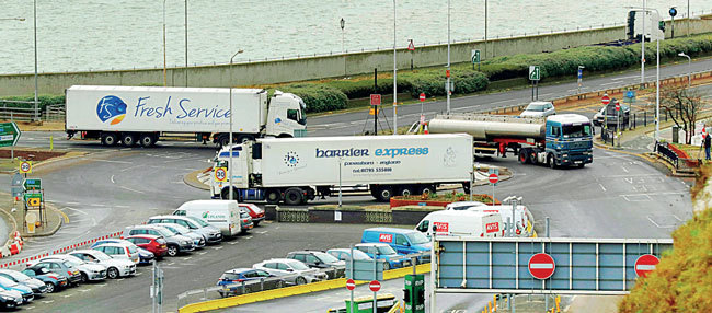 Trucks take part in a no-deal Brexit test, by driving through Dover