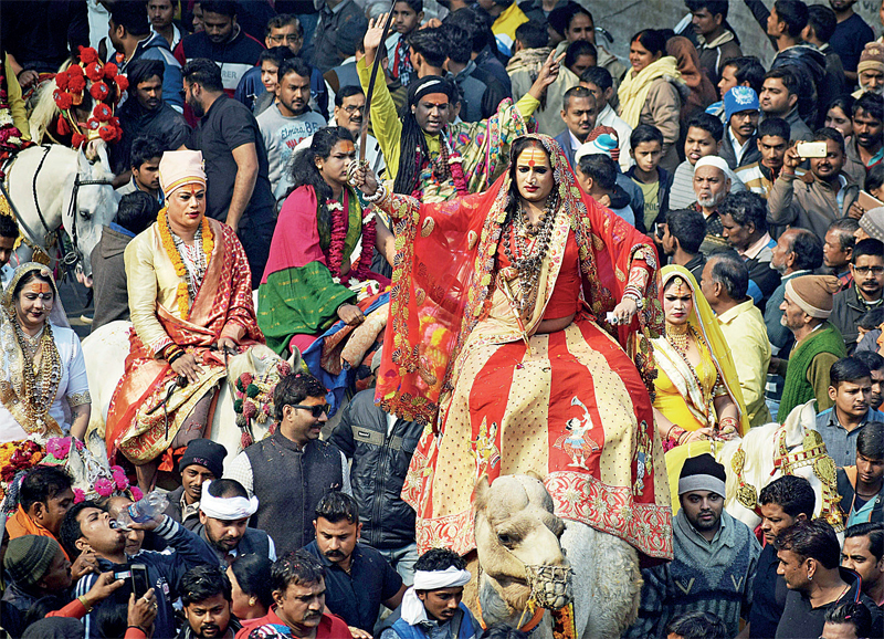 Laxmi Narayan Tripathi and other Kinnar community people take part in a yatra during the Peshwai ceremony for the Kumbh Mela