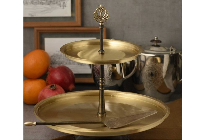 Brass cake stand with server