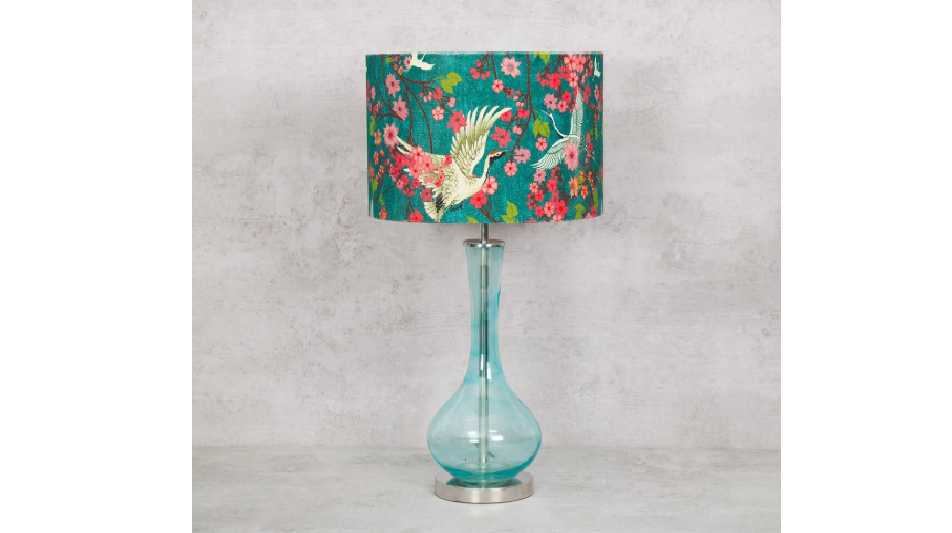 Kitschy lamp with a clear bottle stand