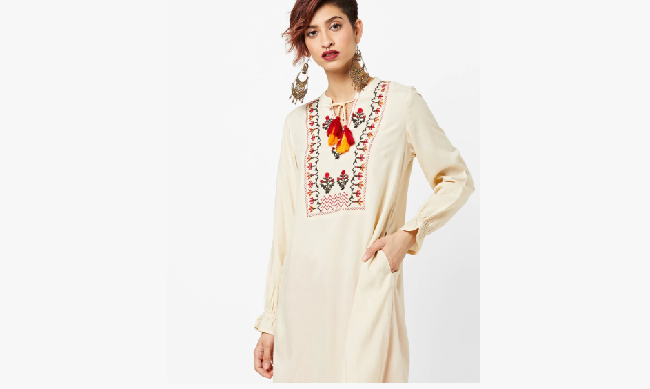 Off-white kurti with colourful embroidery