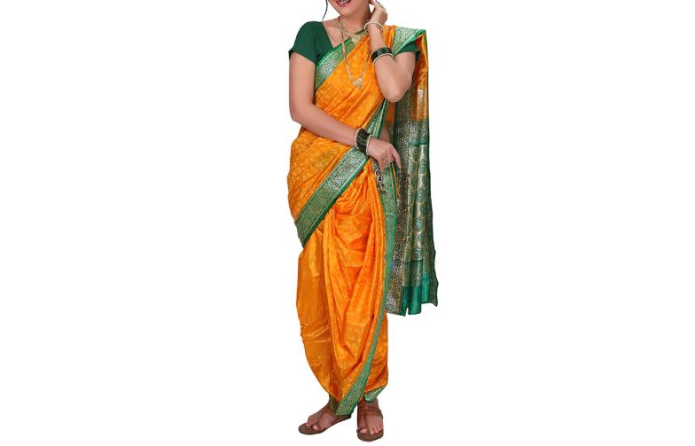 Yellow zari nauvari saree in a Gajaki drape