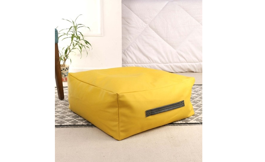 Square yellow floor cushion