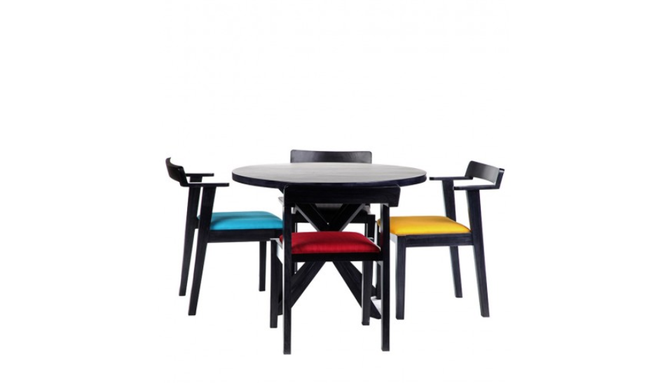 Round dining table set with colourful chairs