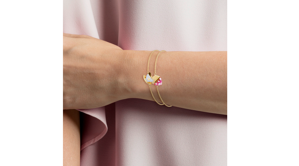 Gold-Toned bracelet with cupcake and tea charm