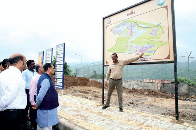 Shyamal Tikadar explaining the zoological park project to CM Rupani